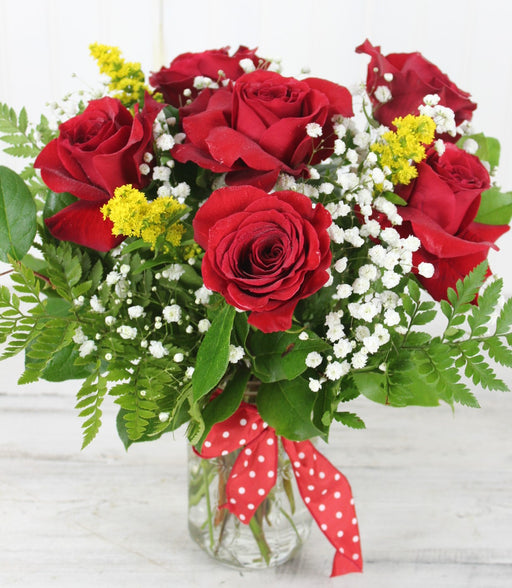 Half Dozen Red Roses with filler in a vase