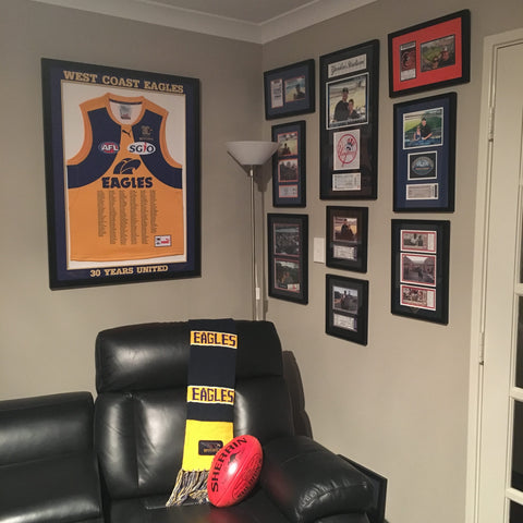 sports memorabilia - picture frames on wall