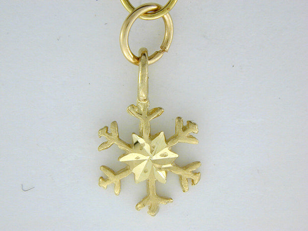 C308  Snowflake with Charm 14kt