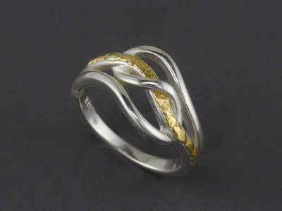 R128  Silver Winding Ring with Nuggets flowing Thru it