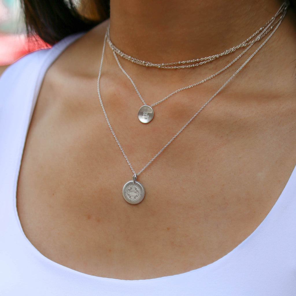 Silver UVA Florentine Necklace Petite on Figure