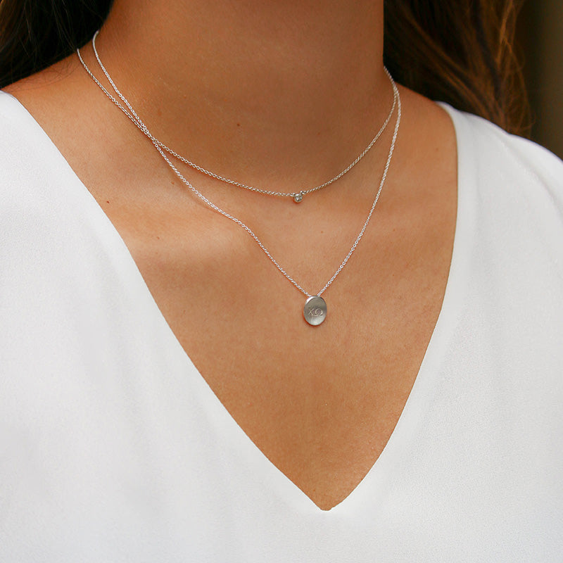 Silver Delta Gamma Letters Necklace Petite on Model