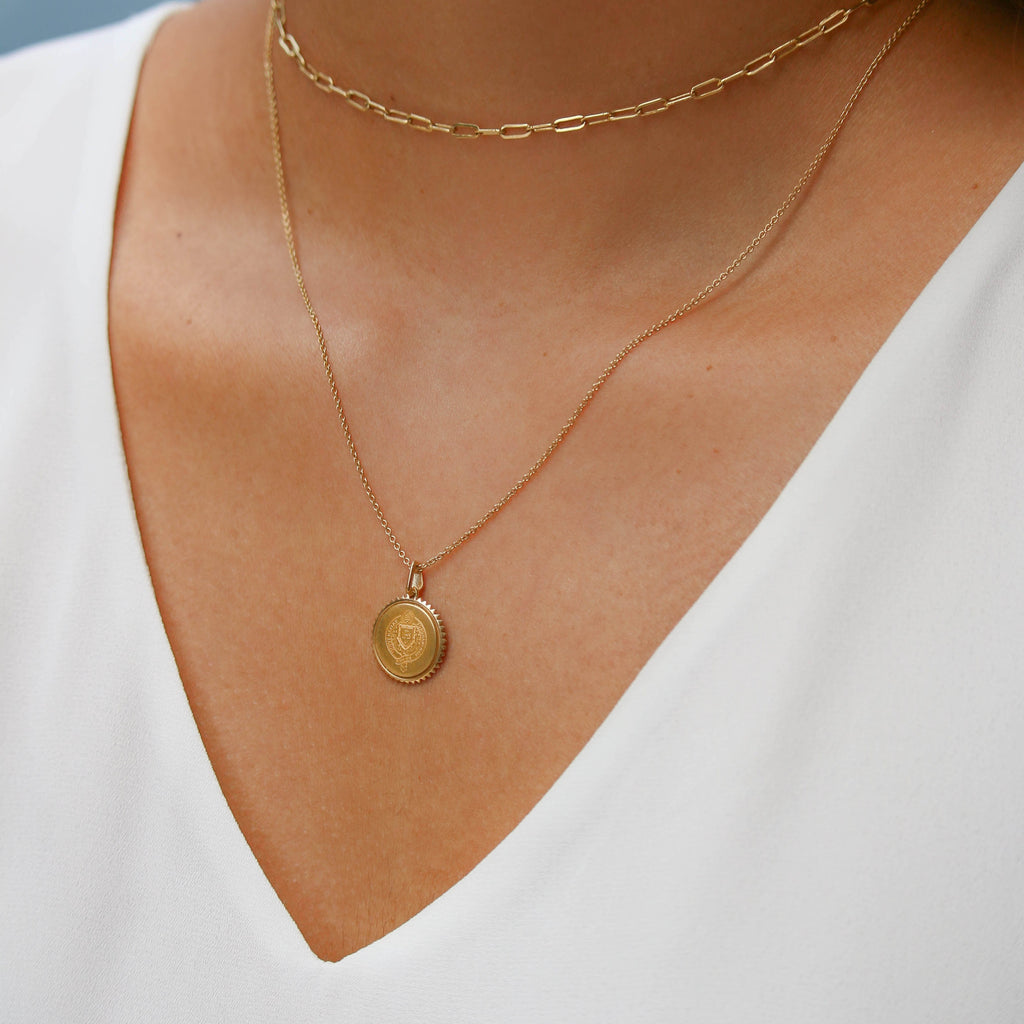 Gold Williams College Sunburst Necklace on Figure