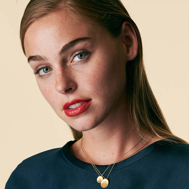 Gold Delta Phi Epsilon Letters Necklace on Model