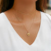 Gold Alpha Xi Delta Sunburst Crest Necklace on Model