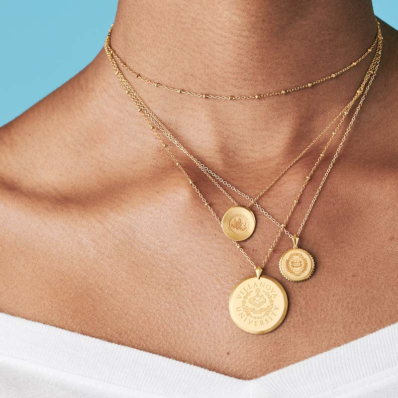 Tuck Shield Sunburst Necklace Dartmouth Gold on model