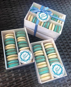 macarons in box with blue ribbon