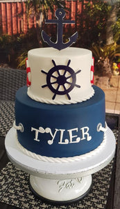 Nautical birthday cake anchor wheel
