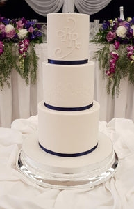 White Wedding Cake with Blue Ribbon