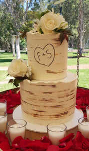 tree bark wedding cake rustic initials carving flowers