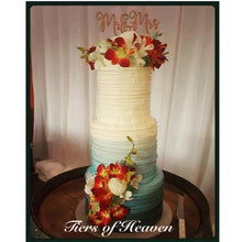 Load image into Gallery viewer, Blue Ombre Wedding Cake with Florals and Wooden Topper