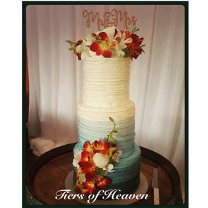 Blue Ombre Wedding Cake with Florals and Wooden Topper