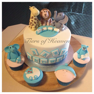 male baby shower cake with cupcakes and animal toppers