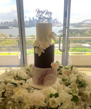 Load image into Gallery viewer, 3 tiered wedding cake with marble base sugar flowers and wooden cake topper