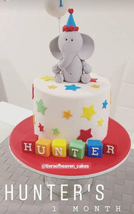 Monthsary cake with grey elephant stars and building blocks