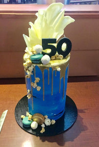 50th birthday drip cake chocolate sail macaron