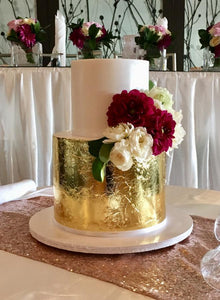 2 tier wedding cake gold leaf flowers
