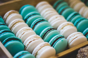 Assorted Macarons in wooden tray