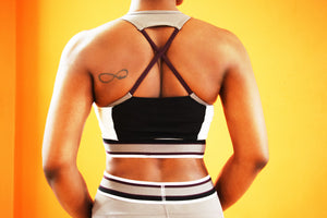 Geometric - Sports Bra back view featuring cross over straps, color block band, mesh back