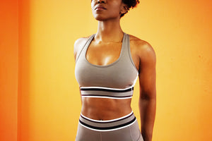 Geometric - Sports Bra front view featuring scoop neckline, color block band under bust