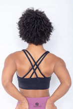 Load image into Gallery viewer, Shakolo crossover bra in black and high waist leggings in purple back view model with arms on top of butt