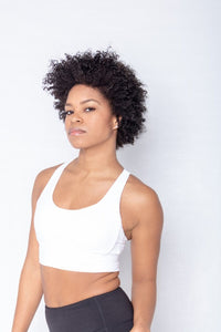 Shakolo crossover bra in white and mid rise leggings in black front view close up