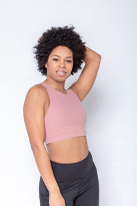 Shakolo high neckline bra in pink and high waist leggings in black front view model with arms behind head