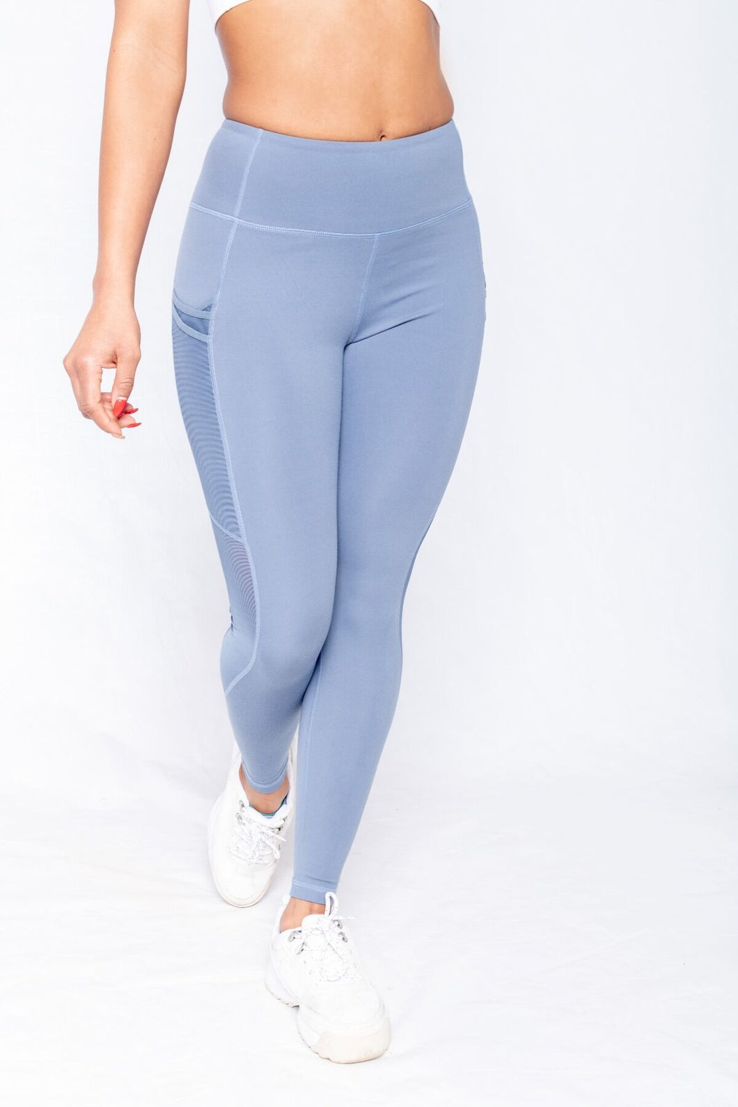 Shakolo mid rise leggings in blue front view with one leg forward