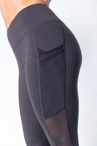 Shakolo mid waist leggings in black side view close up with mesh side