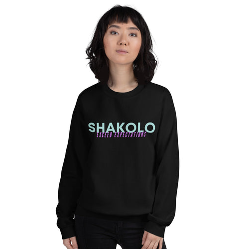 Black crewneck sweatshirt with the words Shakolo exceed expectations written on the front in light blue and purple colors