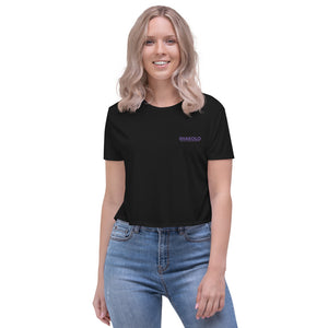Flowy crop top with the words Shakolo Exceed Expectations embroidered on the left side in black