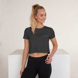 Flowy crop top with the words Shakolo Exceed Expectations embroidered on the left side in grey