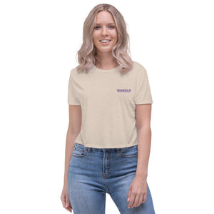 Flowy crop top with the words Shakolo Exceed Expectations embroidered on the left side in beige
