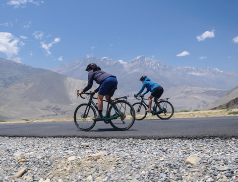 Jennifer Gurecki and Roz Groenewoud cruising on a rare flat road in Nepal.