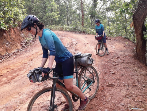 Roz Groenewoud and Jennifer Gurecki navigating a rocky Nepalese dirt road.