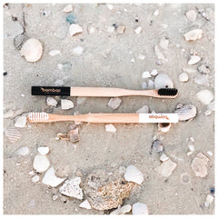 Bamboo Toothbrush on Beach