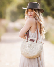 Henrietta Spencer round basket bag with leather and zip. Round straw basket bag, round rattan bag for summer.