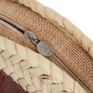 Round straw bag with leather and zips by Henrietta Spencer
