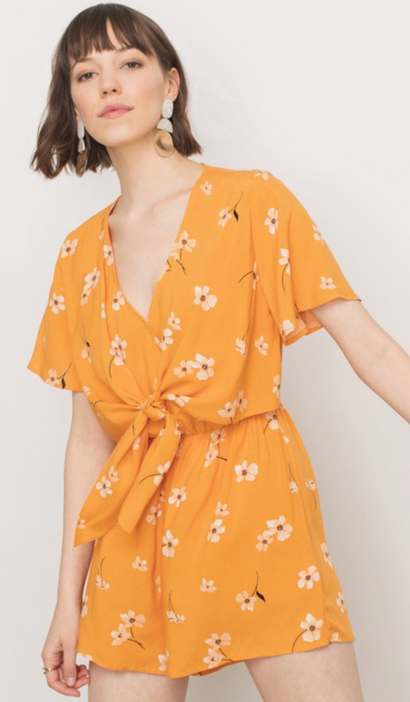 yellow romper with white flowers and front tie