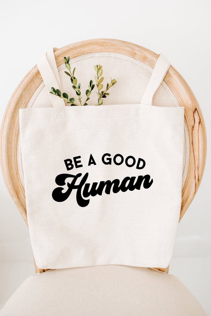 be a good human tote bag