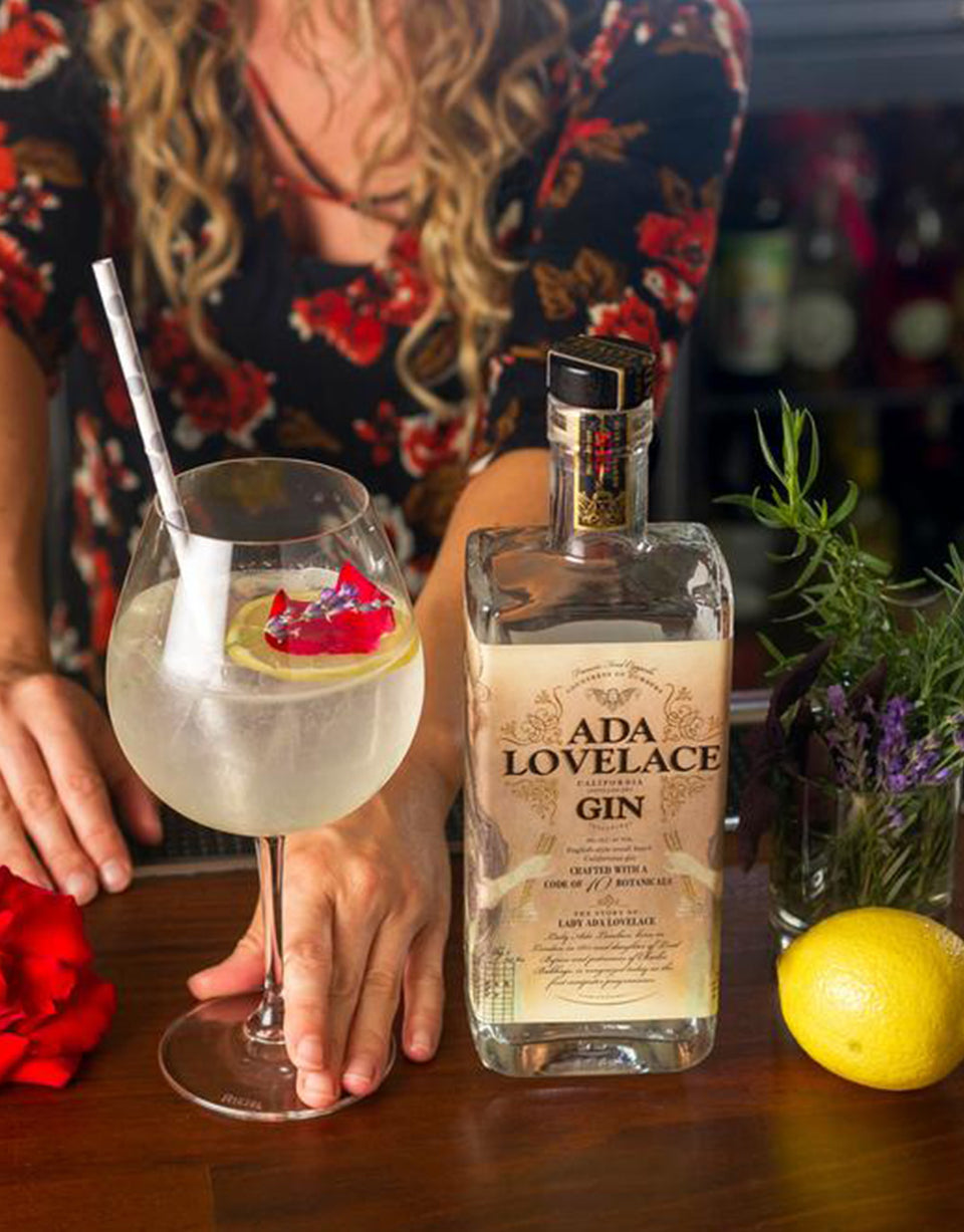 Load image into Gallery viewer, Ada Lovelace Gin bottle on bar with cocktail