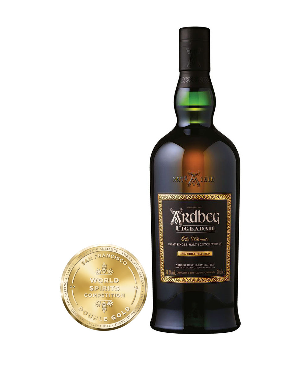 Load image into Gallery viewer, Ardbeg Uigeadail Single Malt Scotch Whisky bottle and awards
