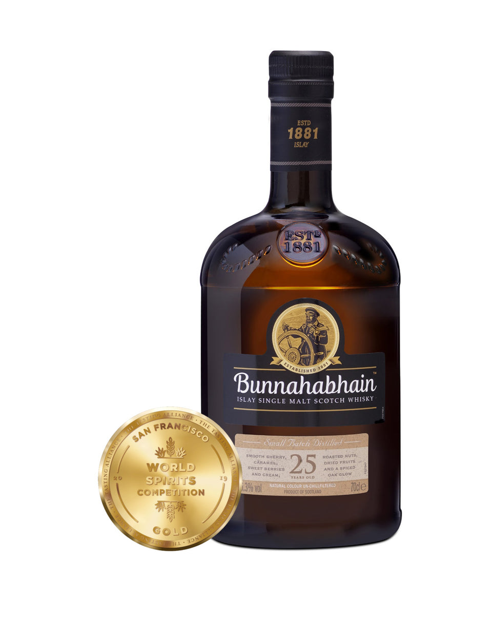 Load image into Gallery viewer, Bunnahabhain 25 Year Old Single Malt Scotch Whisky bottle and awards