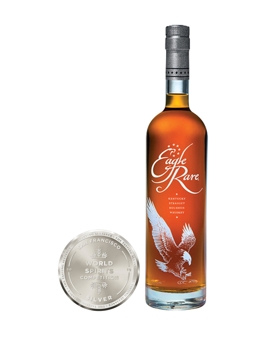 Load image into Gallery viewer, Eagle Rare 10 Years Old Kentucky Straight Bourbon Whiskey bottle and awards
