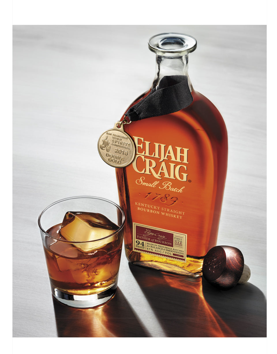 Load image into Gallery viewer, Elijah Craig Small Batch Bourbon Whiskey bottle and glass