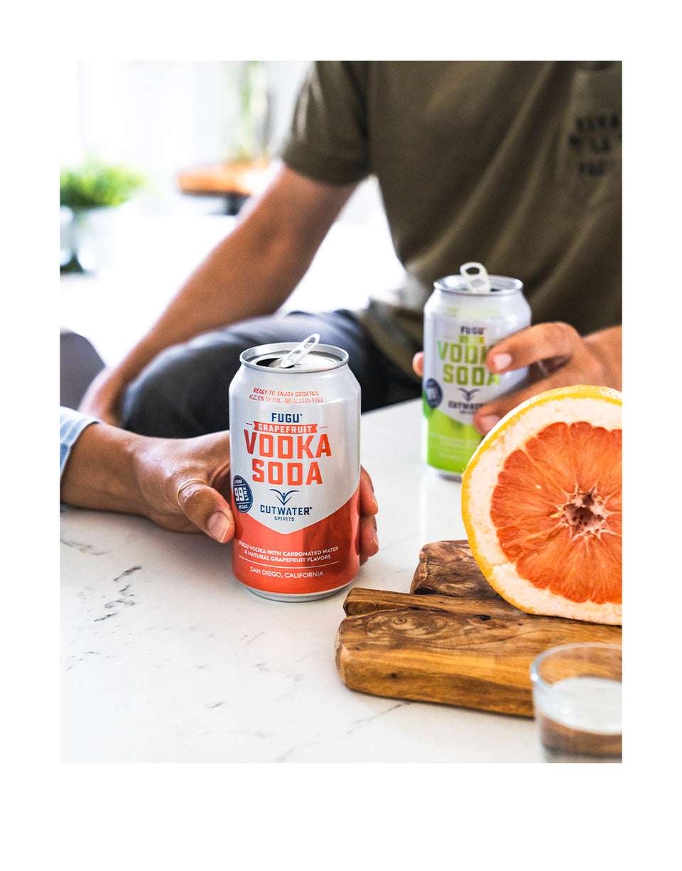 Load image into Gallery viewer, Cutwater Grapefruit Vodka Soda Canned Cocktail in hand