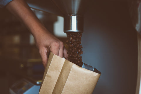 Coffee beans poured in the bag