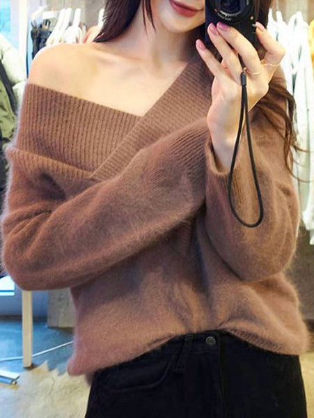 Sexy knit sweater with bare shoulders and V-neck