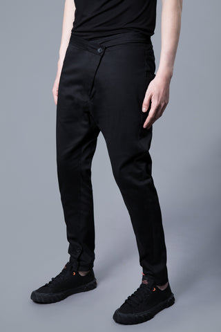 ASYMMETRIC CUT COTTON TROUSERS