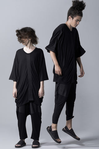 Oversized black shirt with gathered shape